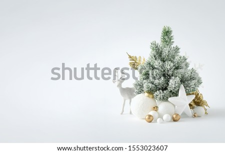 Christmas or New Year layout with white snowy Christmas tree and golden Christmas decoration. Bright  Holiday background. #1553023607