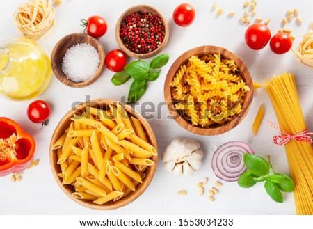 ingredients for italian cousine flat lay, pasta spaghetti penne fusilli tomato oil vegetables #1553034233