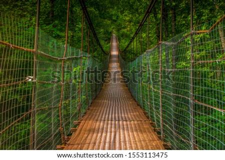 Iron suspension bridge. Suspension bridge #1553113475