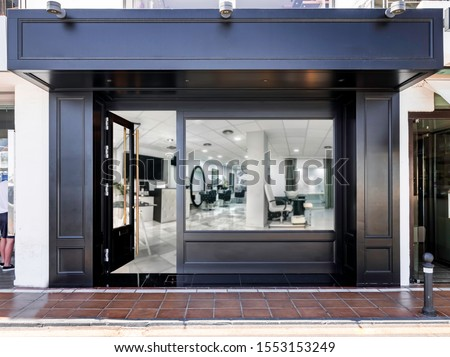 Outdoor mockup,store template,front view black of generic store facade with windows display and blanck posters. #1553153249