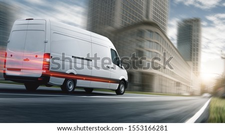 Delivery van delivers fast in a city #1553166281