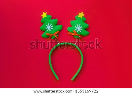 Christmas headband in the shape of funny Christmas trees.