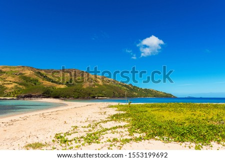 View of the sandy beach of the island, Fiji. Copy space for text #1553199692