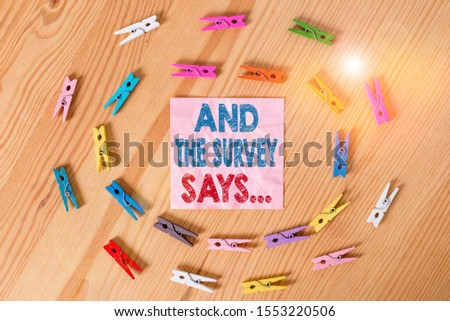 Conceptual hand writing showing And The Survey Says. Business photo text doing poll and bring the results discuss with others Colored crumpled papers wooden floor background clothespin. #1553220506