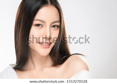 Beautiful Young Asian Woman smile feeling so happy and cheerful. with healthy Clean and Fresh skin. isolated on white background. Beauty Cosmetics Concept