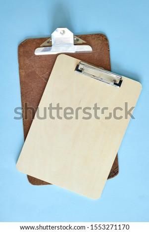 A studio photo of a clip board #1553271170