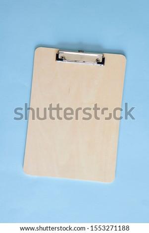 A studio photo of a clip board #1553271188
