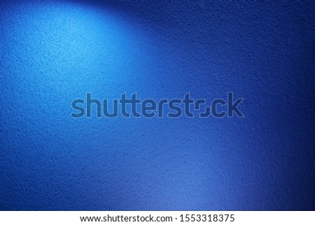 A wide volume beam of light blue on a blue texture background Royalty-Free Stock Photo #1553318375