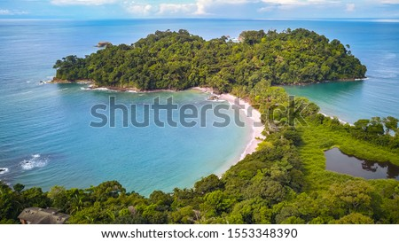 Drone shot of Manuel Antonio Beach near Quepos in Puntarenas. The best National Park in Costa Rica with the highest Biodiversity and lots of Animals, Wildlife, Tropical Plants and beautiful Beaches. #1553348390