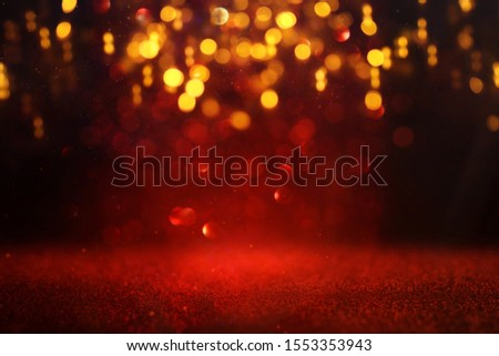 background of abstract red and gold glitter lights. defocused