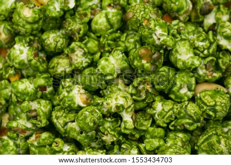 Lush of Japanese matcha green tea popcorn in the wooden bowl bulk isolated on white background #1553434703