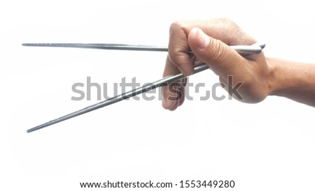 The hand holding the chopsticks on the white blackground. #1553449280
