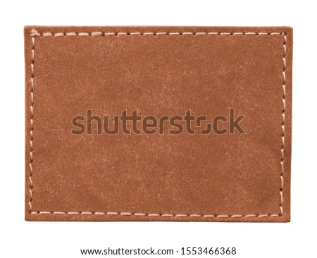 blank reddish-brown leather label isolated on white  #1553466368
