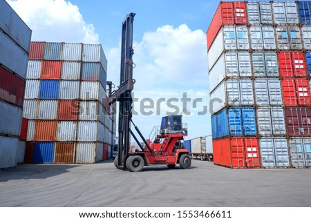 Mobile cranes and containers In the cargo storage yard #1553466611