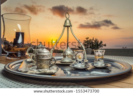 Traditional turkish tea, tea set on sunset