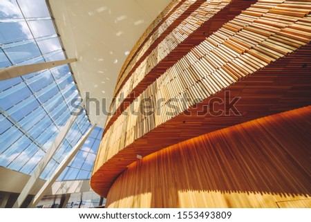 OSLO, NORWAY - JULY 28, 2019: Interior of Opera House in Oslo, Norway. The building is situated in the central Oslo, at the head of the Oslofjord #1553493809