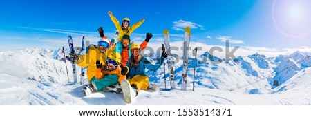 Happy family enjoying winter vacations in mountains, Val Thorens, 3 Valleys, France. Playing with snow and sun in high mountains. Winter holidays. #1553514371