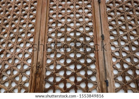 Seoul South,Korea -April 9 2019 : Beautiful decorations carved on the door at Changgyeonggung Palace. The color white is hanji(Korean paper), and it  windbreak and humidity control. #1553849816