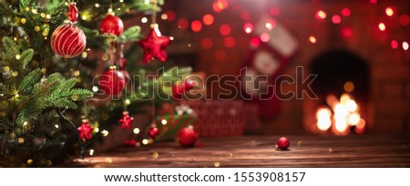 Christmas Tree with Decorations Near a Fireplace with Lights #1553908157