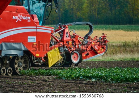 Gifhorn, Germany, October 19., 2019: Red beet harvester from German production at work and harvesting on the field #1553930768