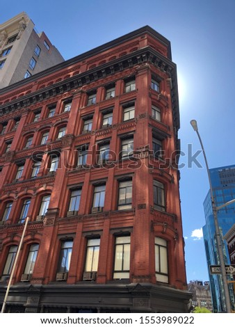 Scenery of NYC including buildings, times square, and the sky #1553989022
