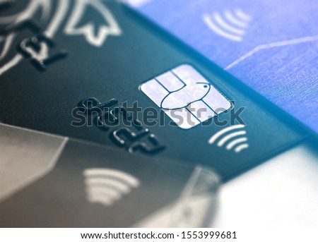 Electronic contactless credit card with selective focus microchip. Macro of a credit card. #1553999681