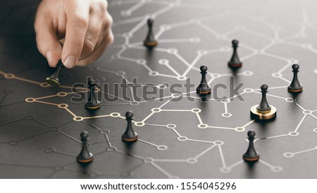 Hand moving pawn on a conceptual maze. Shortcut to success or career guidance concept. Composite image between a hand photography and a 3D background. Royalty-Free Stock Photo #1554045296