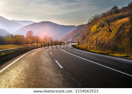 New empty highway in mountains in autumn evening. Road without cars. #1554063923