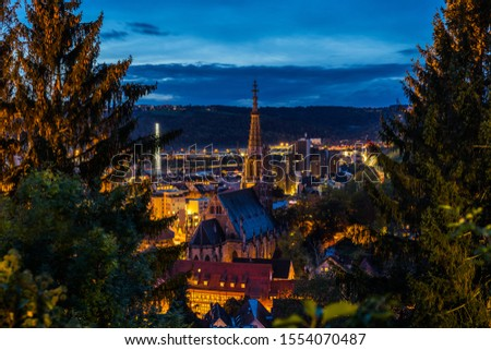Germany, Aerial view above houses and frauenkirche church skyline of medieval city esslingen am neckar by night in magical twilight after sunset #1554070487