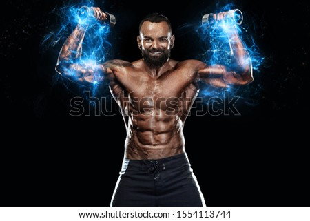 Strong and fit man bodybuilder. Sporty muscular guy with dumbbells. Spot and fitness motivation. Energy and power. #1554113744