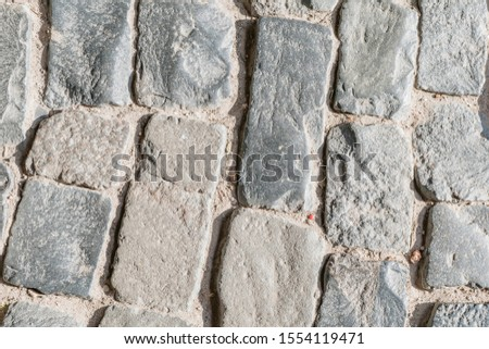 Fragment of a stone road, Paving stones in the old fortress #1554119471