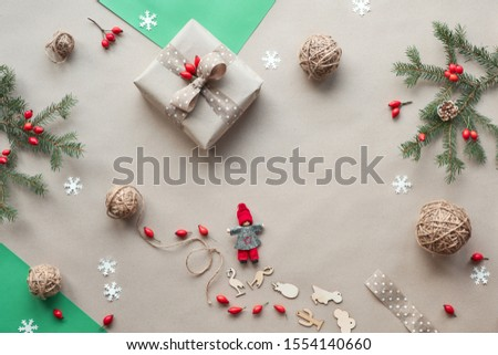 Flat lay, top view on craft paper background..Zero waste Christmas, concept flat layout on rustic wood. Hand crafted gifts, natural Christmas decorations without plastic, eco friendly green Xmas. #1554140660