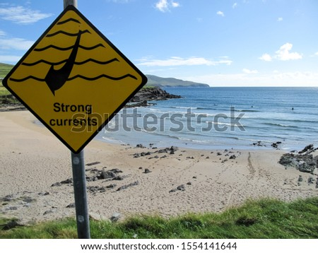Yellow sign of strong currents on a beach frequented by surfers in County Kerry (Ireland). Caution concept #1554141644