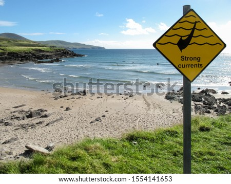 Yellow sign of strong currents on a beach frequented by surfers in County Kerry (Ireland). Caution concept #1554141653