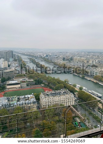 Paris/France - October 2019: City view from above the Eiffel Tower with Seine river and Île aux Cygnes. #1554269069