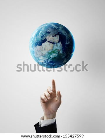 hand pointing at earth, space concept #155427599