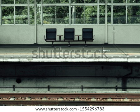 Outdoor three empty passenger seats for waiting at train station #1554296783
