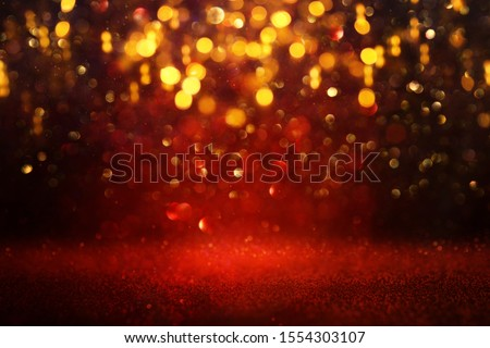 background of abstract red and gold glitter lights. defocused #1554303107