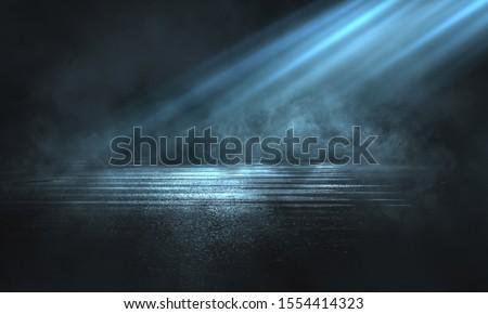 Empty background scene. Dark street reflection on the wet pavement, smoke. Abstract spotlight.  Royalty-Free Stock Photo #1554414323