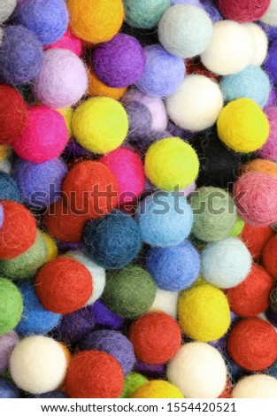 background of wool balls or felt balls.These are the typical christmas ornaments #1554420521