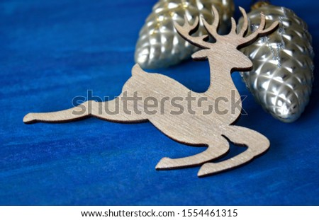 Christmas decorative deer and decorative toys cones on a blue background #1554461315