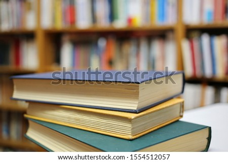 Stack of books in public library #1554512057
