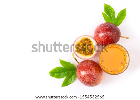 Glass of passionfruit ( maracuya ) juice with passion fruits and half slice with green leaves isolated on white background. top view. Flat lay. Copy space for text. #1554532565