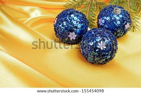 Christmas ball and pine tree branch decoration on yellow silk #155454098