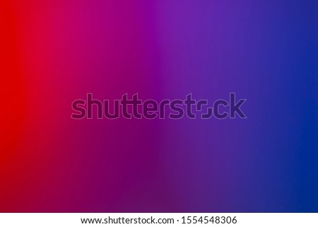 Abstract neon background with red, pink, purple, blue gradient light. Modern glowing neon concept. Royalty-Free Stock Photo #1554548306