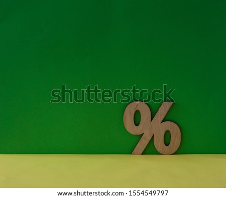 Percentage sign symbol icon on green background, copy space #1554549797