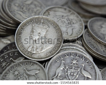 """Untidy pile of old Australian sterling silver Sixpence coins, also known as a """"Half Shilling"""" or a """"Zac"""". Bearing the Southern Cross coat of arms on the reverse and King George V and VI on the obverse #1554565835"""