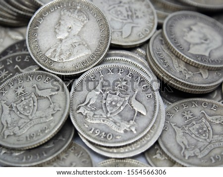 """Untidy pile of old Australian sterling silver Sixpence coins, also known as a """"Half Shilling"""" or a """"Zac"""". Bearing the Southern Cross coat of arms on the reverse and King George V and VI on the obverse #1554566306"""
