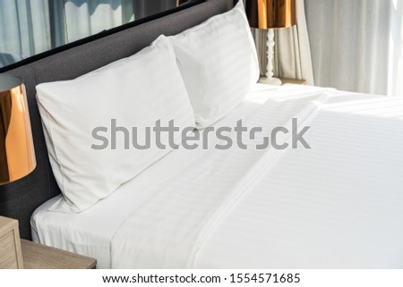 White pillow on bed decoration interior of room #1554571685