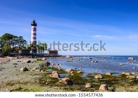 Shepelevsky lighthouse on the picturesque coast of the Gulf of Finland. Beautiful summer view of the Baltic sea coastline, Leningrad region, Russia #1554577436